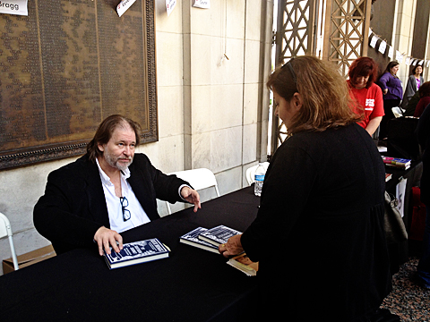 Rick Bragg signing his latest book while chatting with fans