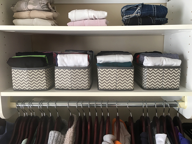 closet with bins for folded t-shirts