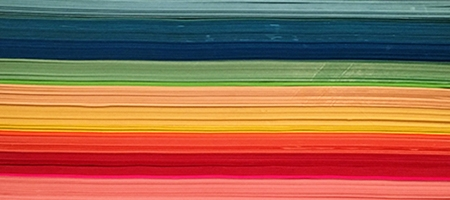 colored paper sorted in rainbow colors