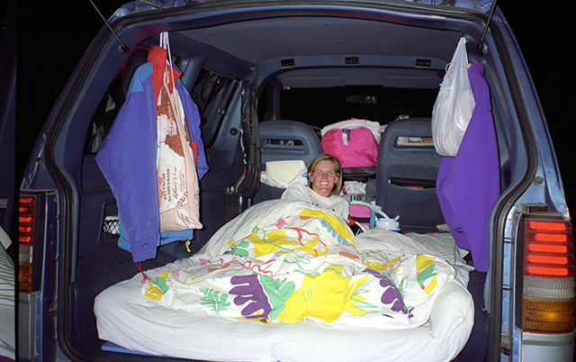 futon mattress as a bed in the back of a minivan