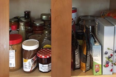 full pantry shelves after grocery store trip